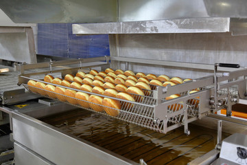 High angle view of buns in containers on production line at factory