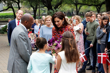 Danish Crown Princess Mary receives flowers as Houston Mayor Sylvester Turner looks on outside the City Hall in Houston