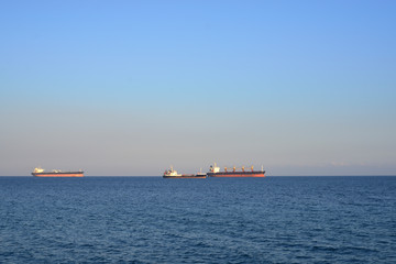 cargo ships on the horizon