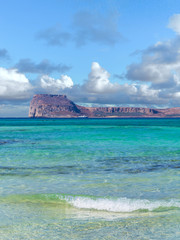 Amazing clear blue water on Balos beach - Gramvousa fortress on the horizon