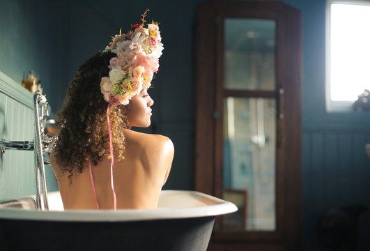 Beautiful woman enjoying a bath