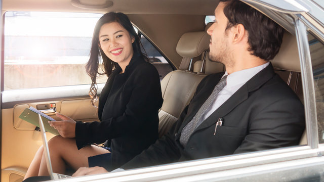 business people smart man and woman talk in back seat car