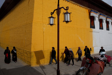 Tibetans circle a temple as part of a prayer ritual at Rongwo Monastery in the largely ethnic Tibetan town of Rebkong