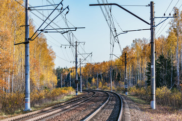 Electric railway lines at autumn day time.