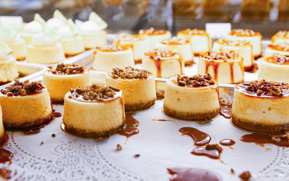 Vanilla Cheesecake pie desserts with caramel and walnut topping