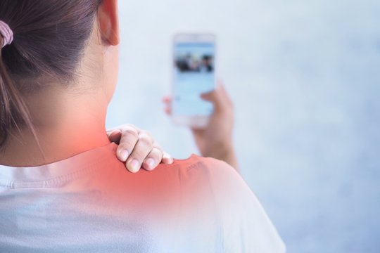 Pain in the shoulder area , Because holding the phone for a long time.