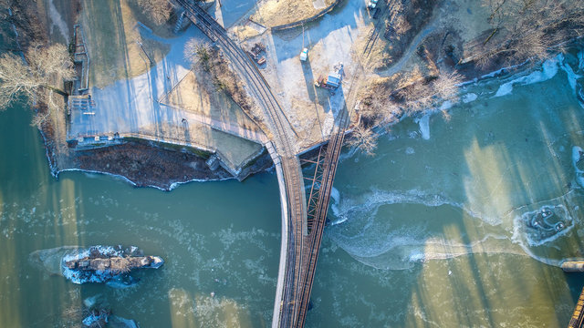 An aerial drone view of the train tracks connecting Harpers Ferry, West Virginia to the surrounding mountains.