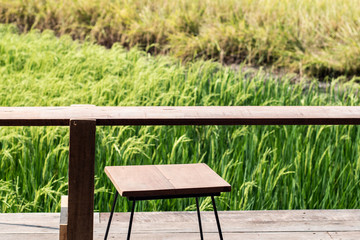 Empty wooden table chair  with view spring summer rice field Asia landscape background