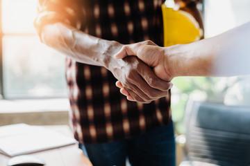 Negotiating business,Image of businessmen Handshaking,happy with work,Handshake Gesturing People Connection Deal Concept.