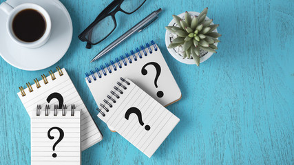 Faq concept on blue wooden background