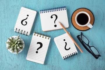 Question marks on notepads, faq concept