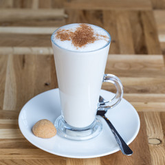 Glass of Turkish milky hot drink sahlep or salep on table