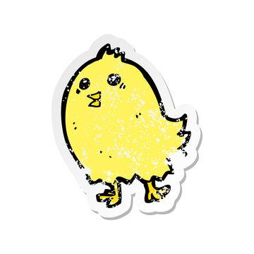 retro distressed sticker of a cartoon happy yellow bird