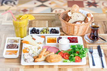 Traditional Turkish Breakfast with various jams, cheeses, olives, beverages and pastry