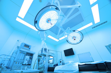 Equipment and medical devices in modern operating room take with art lighting and blue filter