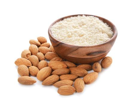 Bowl with almond flour on white background
