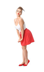 Playful pin-up woman on white background
