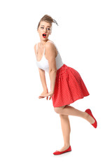 Surprised pin-up woman on white background