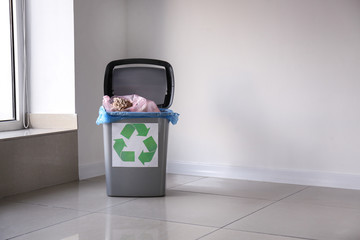 Trash bin with garbage indoors. Recycling concept