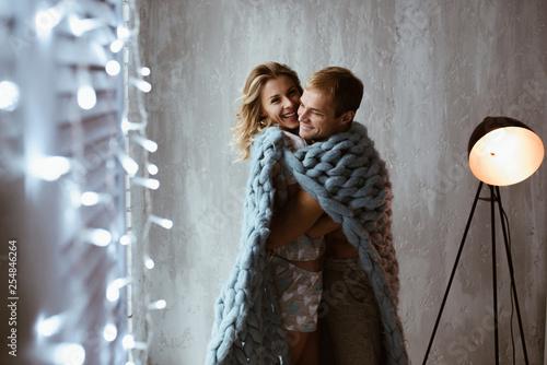Glowing New Year garlands  Stylish interior  couple near