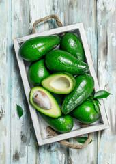 Avocado and avocado slices in white dressing.