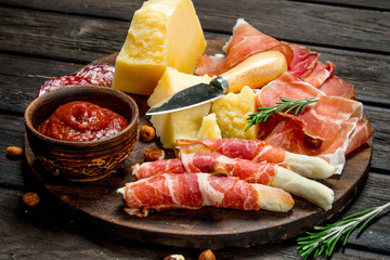 Antipasto background.Board with traditional Italian snacks.