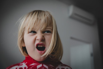 angry little girl shouting at home, agressive child