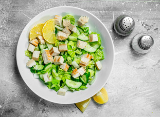 Healthy salad. Salad with cucumbers, chicken and Chinese cabbage poured lemon juice .