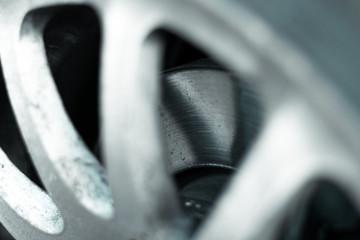Brake disk of the car. Brake disc on white rim