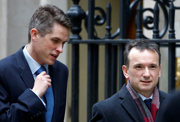 Britain's Williamson and Cairns walk outside Downing Street in London