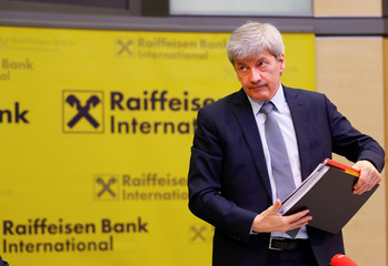 Raiffeisen Bank International CEO Strobl leaves a news conference in Vienna
