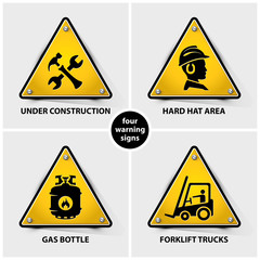 set of yellow warning symbols containing four official international hazard symbols, eps10 vector illustration