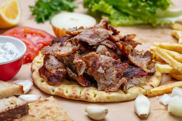 Shawarma, gyros pita. Traditional turkish, greek meat food on pita bread
