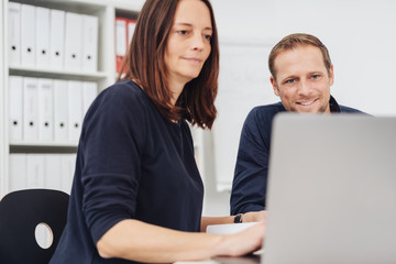 Woman and man working at computer