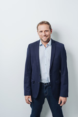 Relaxed confident businessman smiling at camera