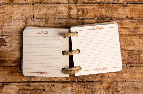Small open notebook on a table