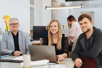 Smiling happy business team in a meeting