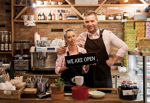 Couple in their new cafe, proud news business owners