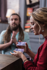 Nice young blonde woman shuffling the cards