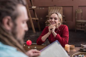 Joyful pretty woman listening to her astrologist