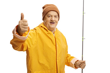 Old man with a fishing rod giving thumbs up