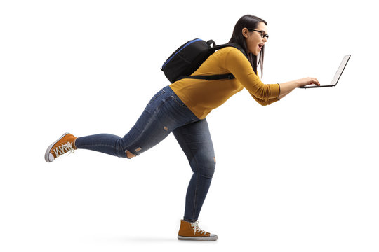 Full length profile shot of a female student running with a laptop isolated on white background