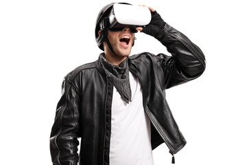 Man in a leather jacket watching on a VR headset