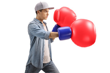 Young male with big red boxing gloves