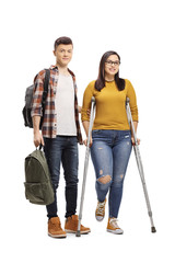 Male student helping a female student walking with crutches
