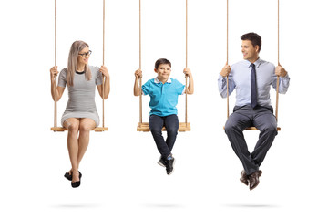 Family of a mother, father and son sitting on swings