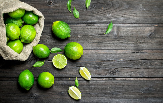 Fresh lime in the sack and pieces of juicy lime.