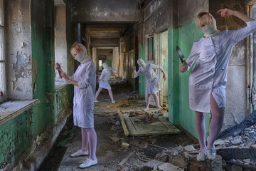 Four identical nurses without faces (head bandaged) zombies with a knife in an abandoned hospital or an insane asylum. Maybe picture for horror movie