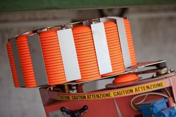 Clay Pigeon Thrower at Shotgun Range filled with orange targets - saucer.