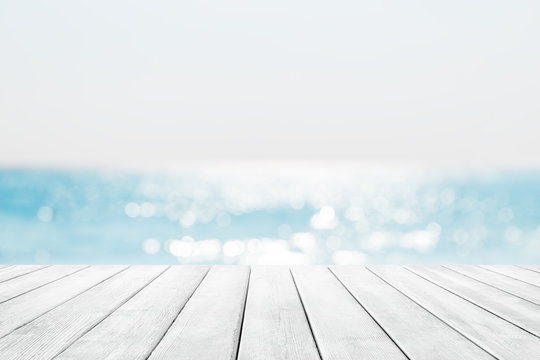 Blurred blue sky and sea with bokeh light